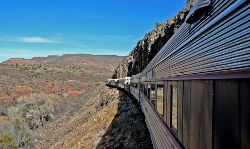 Located in the red rock country near Sedona, Verde Canyon Railroad's rare ribbon of rails runs through a dramatic high desert landscape adjacent to a precious riparian ecosystem. Since 1912 this heritage railroad, sandwiched between two protected national